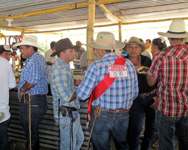 Cabalgata Cowboys mosey up to the bar